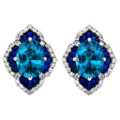 IGL Certified 1.40 Carat Oval Blue Zircon Sapphire 14K Scalloped Stud Earrings