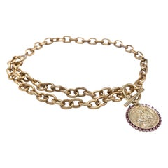 Gold plated choker chain necklace with Virgin Mary medal and pink rhinestones