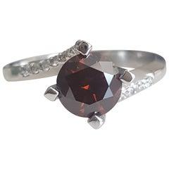 GIA 1.29 Carat Natural Fancy Dark Orange Brown Round brilliant Diamond Ring.