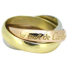 Must de Cartier Trinity Rolling Yellow White Rose Three-Color Gold Band Ring