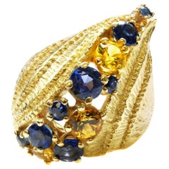 1980s Yellow and Blue Sapphire Sculptural 18 Karat Yellow Gold Cocktail Ring