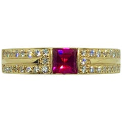 Carelle 18 Karat Yellow Gold Diamond and Ruby Contemporary Ring