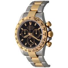 Rolex 18 Karat Gold Stainless Steel Daytona Black Dial Automatic Wristwatch