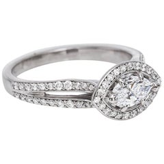 14 Karat White Gold and Marquise Diamond Ring with Diamond Halo