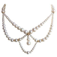 Graduated White Pearl Necklace 14 Karat Yellow Gold Beads and Clasp