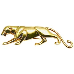 Cartier 18 Karat Yellow Gold Panthere Brooch with Emerald Eyes and an Onyx Nose