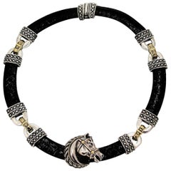 Nancy and David Silver, Gold and Black Leather Horse Necklace