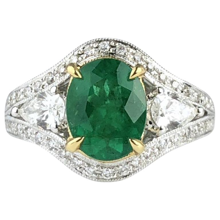 1.70 Carat Oval Cut Fine Emerald and 0.73 Carat Diamond Ring in 18 Karat Gold For Sale