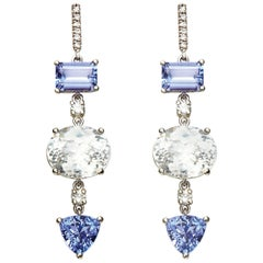 Tanzanite, White Zircon and Diamond Dangle Earrings Set in 18 Karat White Gold