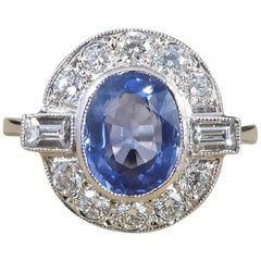 1.65 Carat Sapphire and Diamond Cluster Engagement Ring mounted in Platinum