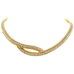 1980s Chic 18 Karat Yellow Gold Diamond Crossover Necklace