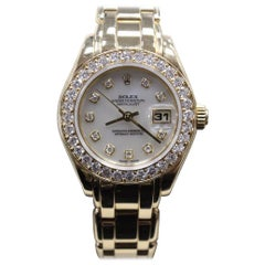 Rolex Pearlmaster 69298 Mother of Pearl Diamond Dial and Bezel 18 Karat Gold