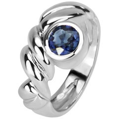 0.78 Carat Round Blue Sapphire in 18 Karat Gold Inverted Collet with Carved Band