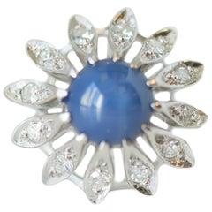 1950s 1 Carat Blue Star Sapphire, Diamond and 14 Karat White Gold Floral Ring