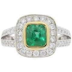 Diamond and Emerald Split Shank Ring in 18 Karat