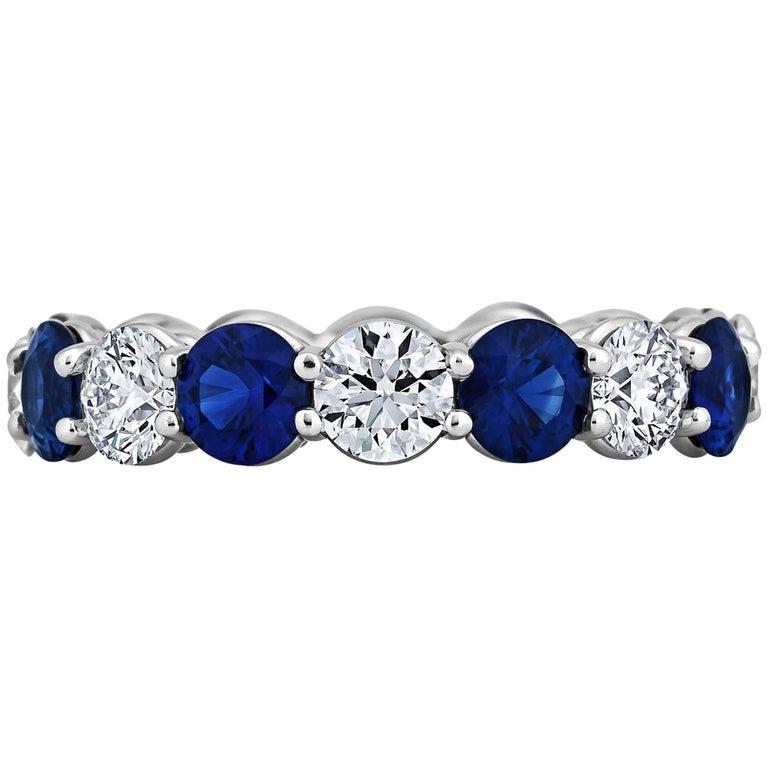 Round Diamond Sapphire and Platinum Band Ring