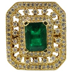 Estate 18 Karat Yellow Gold 1.50 Carat Emerald and Diamond Halo Shield Ring