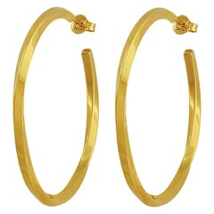 Tiffany, a pair of twist hoop earrings English hallmarked 18 ct yellow gold