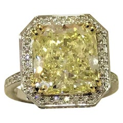 GIA Certified 6.70 Carat Radiant Fancy Yellow Diamond Cocktail Ring