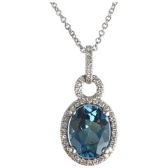 2.15 Carat Vivid Blue Topaz and Diamond Oval Halo Drop Pendant in 14 Karat Gold