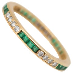 1950s Emerald and Diamond Eternity Band in 18 Karat Yellow Gold