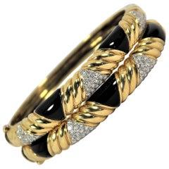 Pair of Gold, Onyx and Diamond Bangle Bracelets