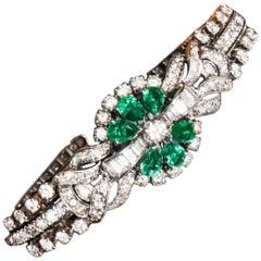 1940s 13 Carat Gubelin Platinum Emerald Diamond Flower Concealed Bracelet Watch