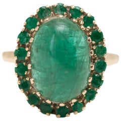 1960s 5 Carat Total Emerald Cabochon with Halo Ring in 14 Karat Yellow Gold