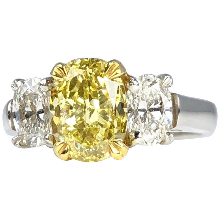 GIA Certified 2.01 Carat Natural Fancy Intense Yellow Diamond Ring in Platinum For Sale