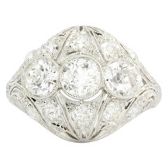 Art Deco Three-Stone Diamond Platinum Filigree Ring, circa 1930s