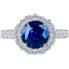 3.97 Carat GIA Round Natural Blue Sapphire Set in 18 Karat Diamond Halo Ring