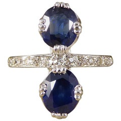 1930s Horizontal Two-Stone Sapphire Ring with Half Diamond Set Platinum Band