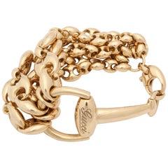 1990s Gucci Horseshoe Bit and Gucci Link Design Flexible Gold Bracelet