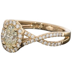 Rose Gold Oval Diamond Twisted Shank Halo Engagement Ring