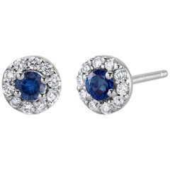 White Gold Halo Sapphire Diamond Earrings Weighing 0.60 Carat