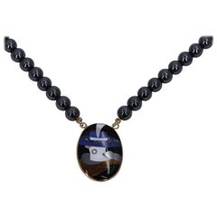 Intricate Stone Inlay Portrait Pendant with Hematite Bead Necklace