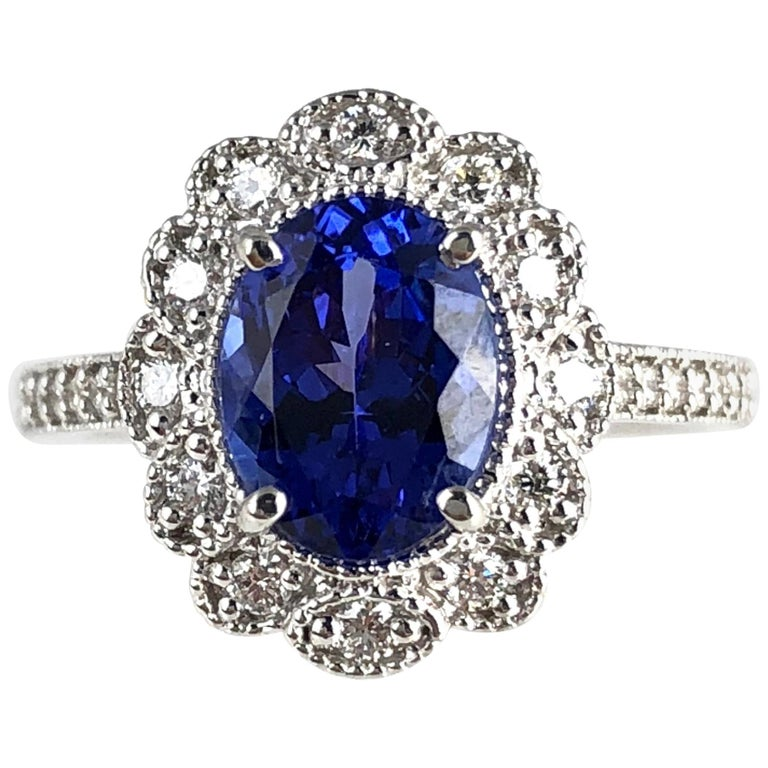 2.06 Carat Vivid Blue Tanzanite and 0.34 Carat Diamond Cocktail Cluster Ring For Sale