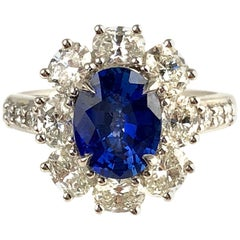 GIA Certified 1.89 Carat Oval Cut Ceylon Sapphire and Diamond Cluster Ring