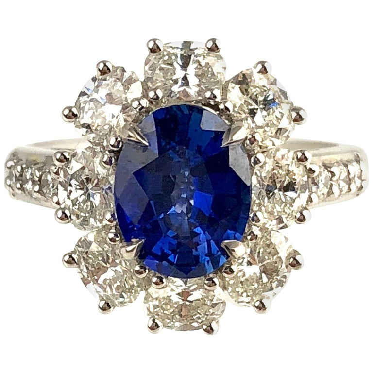 GIA Certified 1.89 Carat Oval Cut Ceylon Sapphire and Diamond Cluster Ring For Sale