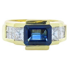 1.75 Carat Blue Sapphire with Invisible Set Princess Cut Diamond Cocktail Ring
