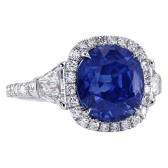 AGL Certified 6.97 Carat Cushion Blue Sapphire Diamond Halo Three-Stone Ring