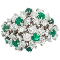 1960s Emerald and Diamond Flower Ring by Oscar Hayman