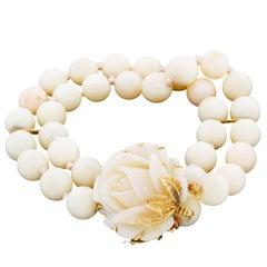 Vintage Elegant 14 Karat Gold Carved Angel Skin Coral Bracelet Flower Clasp
