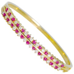 Natural Diamond 1.31 Carat and Ruby Bangle Bracelet 14 Karat Gold 21.40 Grams