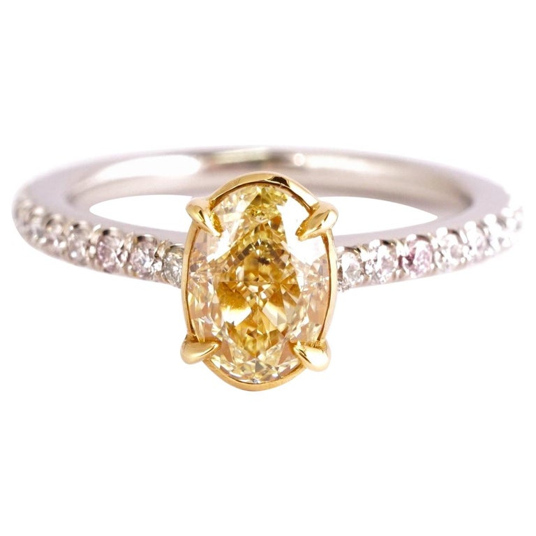 Fancy Yellow 1.12 Carat Oval Cut Diamond Engagement Platinum Ring For Sale