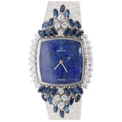 Magnificent Ladies Wristwatch, Omega 18 Karat Gold with Diamonds and Sapphires