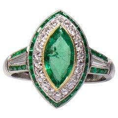 Platinum and 18 Karat Yellow Gold Art Deco Emerald and Diamond Ring