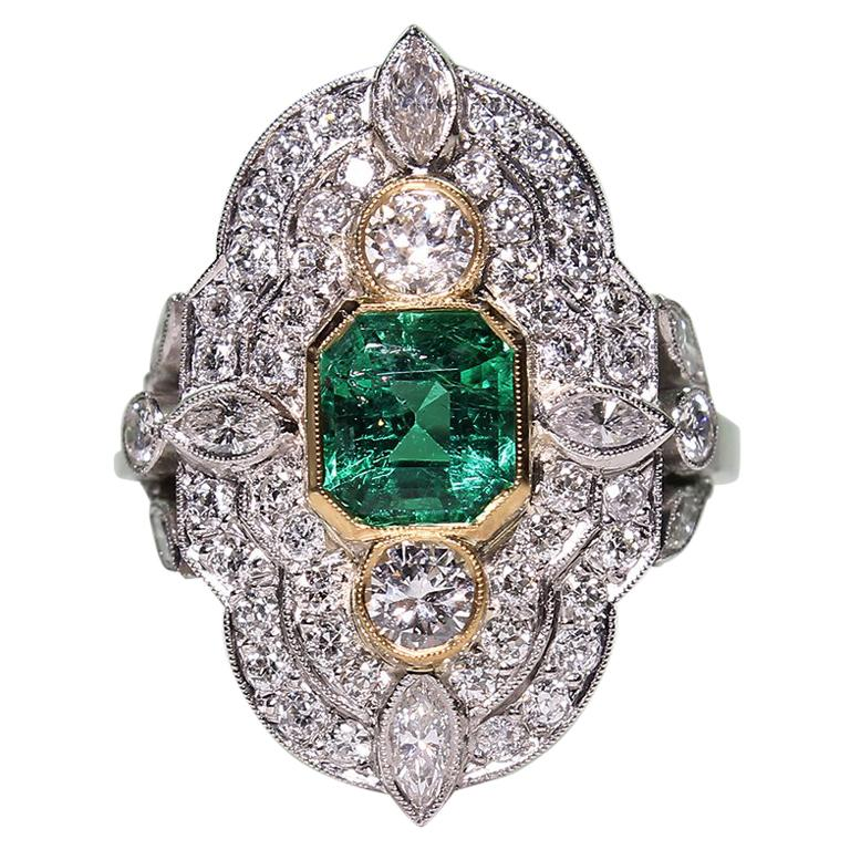 Platinum and 18 Karat Yellow Gold Art Deco Emerald and Diamond Ring For Sale