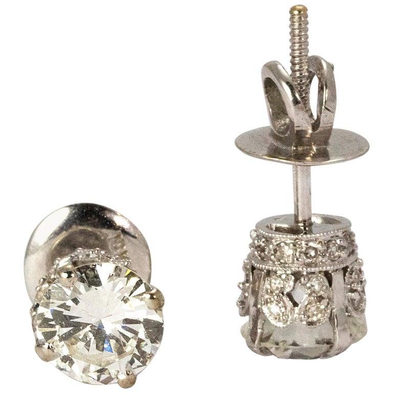 Art Deco Certified 1.94 Carat Diamond Platinum Stud Earrings For Sale