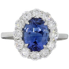 GIA Certified 3.48 Carat Oval Sapphire and Diamond Halo Ring